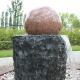 Granieten waterornament in kinderhofje. Begraafplaats Rhijnhof Leiden.